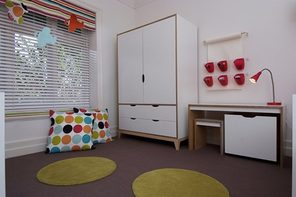 Chartruesse, red, brown and blue really pop against the custom white joinery in this bedroom for two little boys.   http://www.kidsindesignedspaces.com.au/residential/juniorproject1