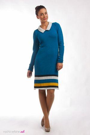 Rochie tricotata de culoare albastra - Rochie tricotata cu maneca lunga, de culoare albastra. Este decoltata rotund la baza gatului, are guleras bej iar la poale are dungi de culoare bej, negru si galben. Colectia Rochii de toamna iarna de la  www.rochii-ieftine.net