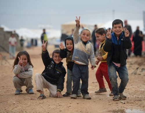 syrian kids in the za'atari jordanian refugee camp, home to over 100,000 syrian refugees. jordan now houses more than a third of the over 1.5 million syrian refugees, about half of whom are children. photo jeff j. mitchell.