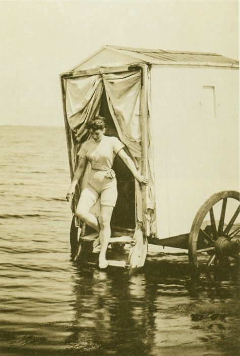 Wilhelm Dreesen photograph, this one taken in 1893, shows a young woman in a one piece bathing costume exiting a bathing machine on a North Sea beach.