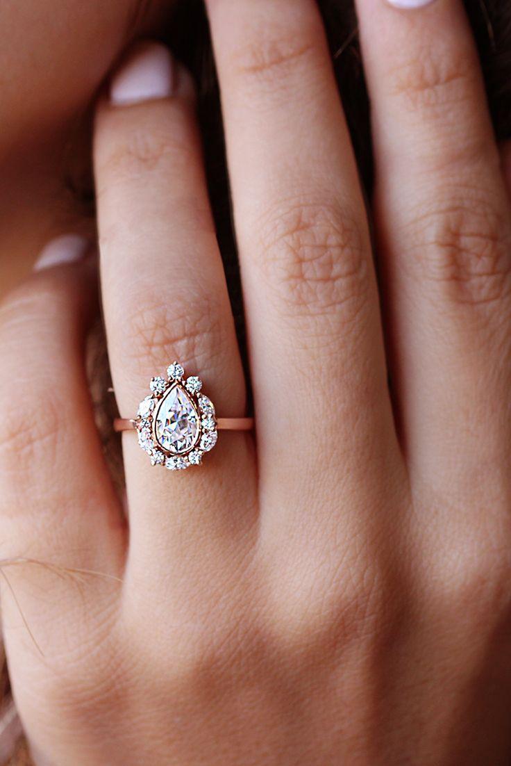 Unique Pear Moissanite 1 5 Carat Center With Diamond Halo Unique Engagement Ring Ballerina Engagement Rings Marquee Engagement Rings Wedding Rings Engagement
