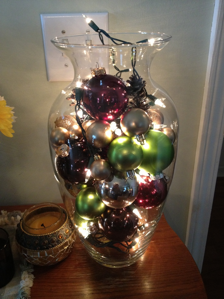 DIY Lamp. My mom made this : Large Urn vase from any thrift store, 50 light strand of small lights and any thing you want to add (pine cones, Christmas ornaments, etc.)-- Makes a great night light!!
