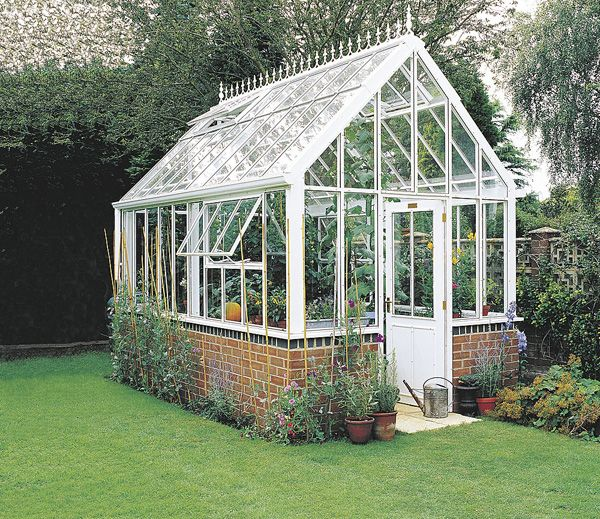 old windows ~ greenhouse with brick or stone base...got an old shed or out building that is no longer useful or might not be in the best shape but the bottom half is still good? tear off the top part and convert foundation and wall bases into a greenhouse