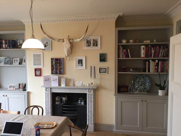 A pair of bespoke fitted alcove unit, traditional dresser style, with book shelves and panelled door cupboards for a living room or dining room. MDF painted in light grey. Made by Oliver Hazael Bespoke Carpentry and Plastering in Bath, Somerset #alcove #storage #bookshelf #bookshelves #dresser #bespoke #Georgian #Victorian