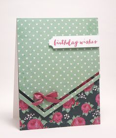 Avery Elle ... handmade card ... coordinating patterned papers ... die cut corner detailing/tilted corner ... cute little bow emphasized the panel placement ... like it!