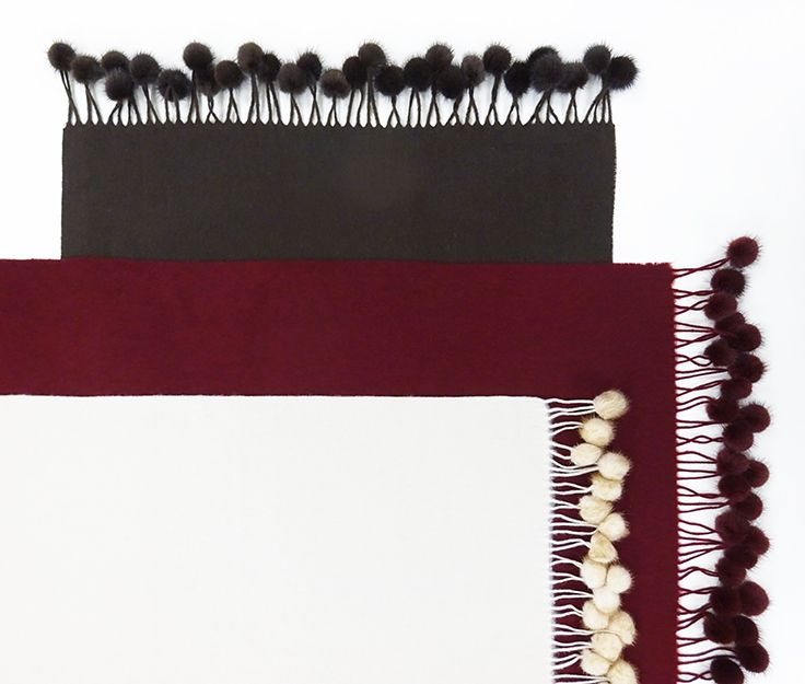 Cozy cashmere throws with mink pom poms in a selection of colors. $239.99 each. L.A. Moves 703-415-0500