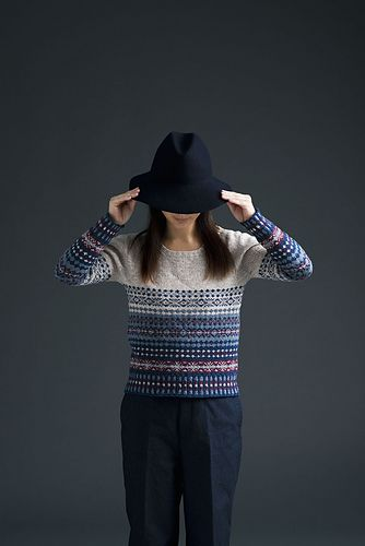 "A top down pullover in fair isle colorwork. To avoid steeking, the colorwork is used for the body and sleeves knit in the round. The patterns are simple enough for people who are trying colorwork for the first time. Hope this will encourage you to try your ""first fair isle"" project."