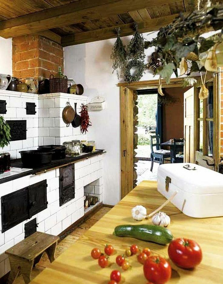 adelaparvu.com despre casa rustica si pensiune la Jemna, Foto Michael Skorupski , Barry Fisher, bucatarie rustica cu soba din teracota (5)