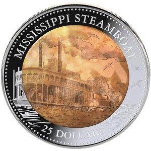 """""""Parowiec na rzece Missisipi"""" to moneta upamiętniająca upływającą w 2015 roku 180. rocznicę urodzin Marka Twaina. Ojciec amerykańskiej literatury zapewnił nieśmiertelność XIX-wiecznym, imponującym parowcom pływającym po amerykańskich rzekach w swojej autobiografii pt. """"Życie na Missisipi""""  Skarbnica Narodowa"""