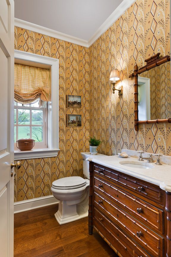 A guest bathroom with warm wood tones