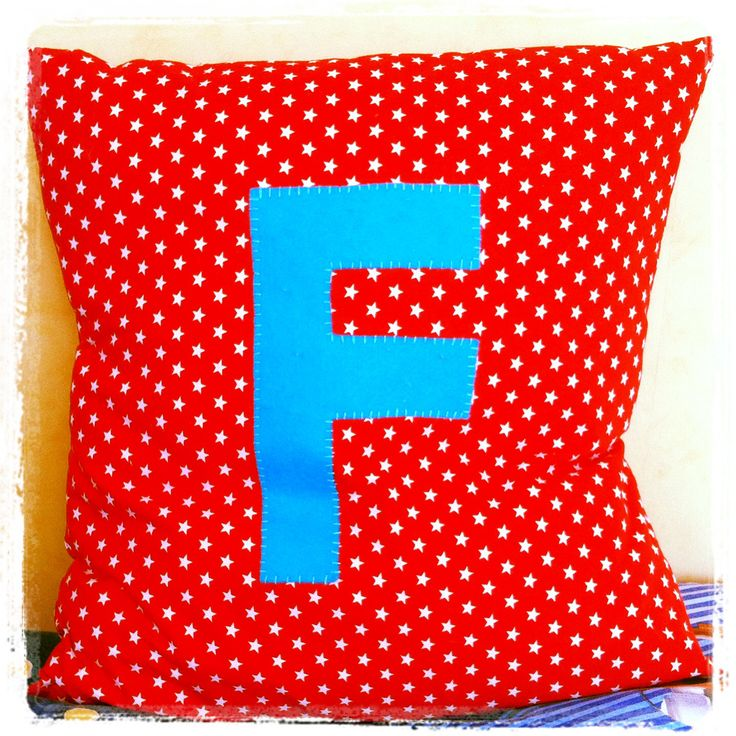 Personalised pillow made for my toddler's bedroom, made to match 'Thomas the Tank Engine' colours of red and blue.