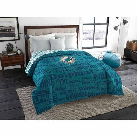 """NFL Anthem Twin/Full Bedding Comforter Only, Miami Dolphins:   This officially licensed NFL """"Anthem"""" Twin/Full Comforter by The Northwest Company is the perfect way to boldly show off that you're a true football fan. This super-cozy comforter is coordinated to match your favorite NFL team's true colors. This fan-worthy comforter features various word marks and logos printed as a background and a bold, full color logo in the center. Cuddle like a true fan under this comforter; you'll be..."""