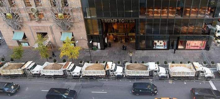 Απίστευτο: Φορτηγά γεμάτα άμμο προστατεύουν τον ουρανοξύστη του Τραμπ στο Μανχάταν [εικόνες]