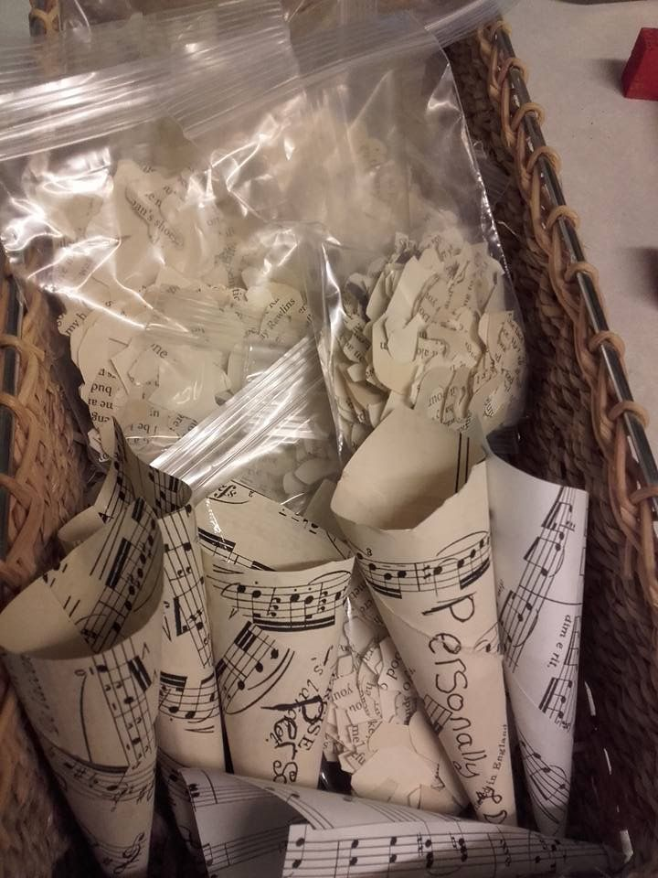 Horseshoe and bell  bespoke confetti cut  by hand out of old romance novels.