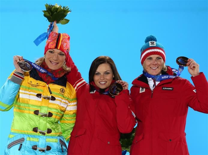 Silver medalist Maria Hoefl-Riesch of Germany, gold medalist Anna Fenninger of Austria and bronze medalist Nicole Hosp of Austria on the podium during the medal ceremony for the Alpine Skiing Ladies Super-G on day 9 of the Sochi 2014 Winter Olympics at Medals Plaza