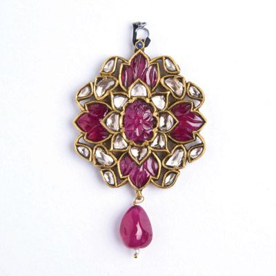 Ruby and diamond pendant  A fine drop pendant inset in the kundan style with carved rubies and diamonds. www.ollemans.com SOLD