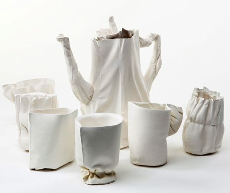 """Artist: Rachel Boxnboim; """"Alice"""", ceramic tea service cast inside fabric moulds.  Boxnboim pours the liquid clay into stitched moulds and gradually syringes it out again, leaving a thick layer clinging to the inside of the fabric.  The cloth burns away when fired.  rachelboxnboim.com"""