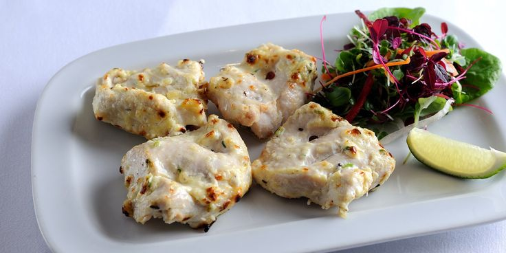Malai tikka  Malai tikka refers to grilled supreme of chicken with ginger, garlic, green chilli, cream-cheese, coriander-stem and cardamom. Alfred Prasad's recipe really punches above its weight, the dense flavours belying the simple preparation.