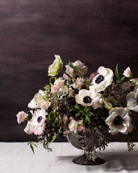 I like the idea of blush and dark burgundy against deep green foliage for a Christmas flower arrangement.