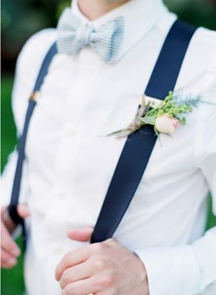 Navy suspenders add a bold pop to the groom's and groomsmen's outfits.