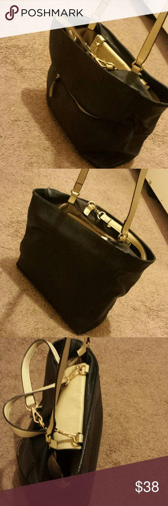 Zara tote bag Zara tote bag,  two pockets on the inside,  one zipped pocket on the outside. Black leather feel. Gently used. Zara Bags