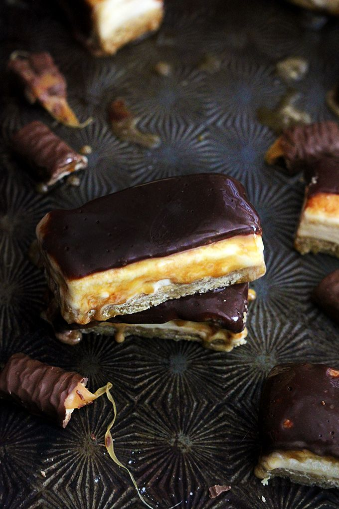 Buttery shortbread bars topped with vanilla ice cream, caramel, and milk chocolate - a Twix inspired frozen treat!