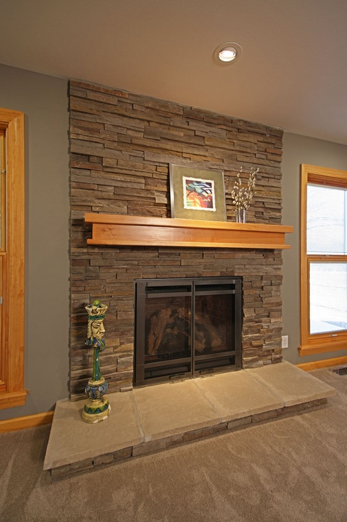 Updating a 1960s ranch home fireplace to be more contemporary. More photos of this project at: http://bit.ly/KWImHn