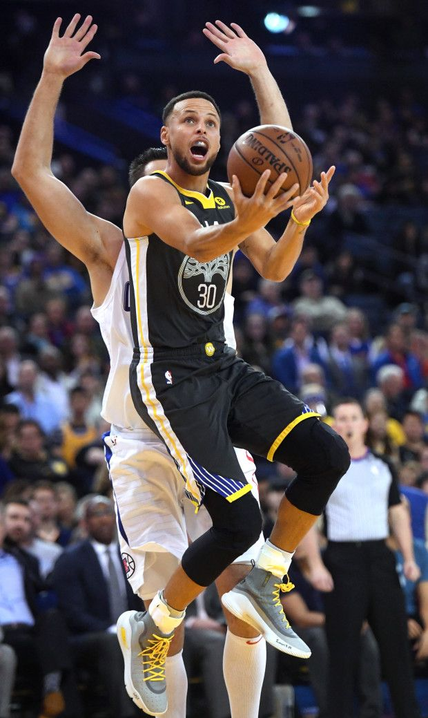 Golden State Warriors' Stephen Curry (30) gets past Los Angeles Clippers' Danilo Gallinari (8) for a basket in the first period of their NBA game at Oracle Arena in Oakland, Calif., on Thursday, Feb. 22, 2018. (Doug Duran/Bay Area News Group)