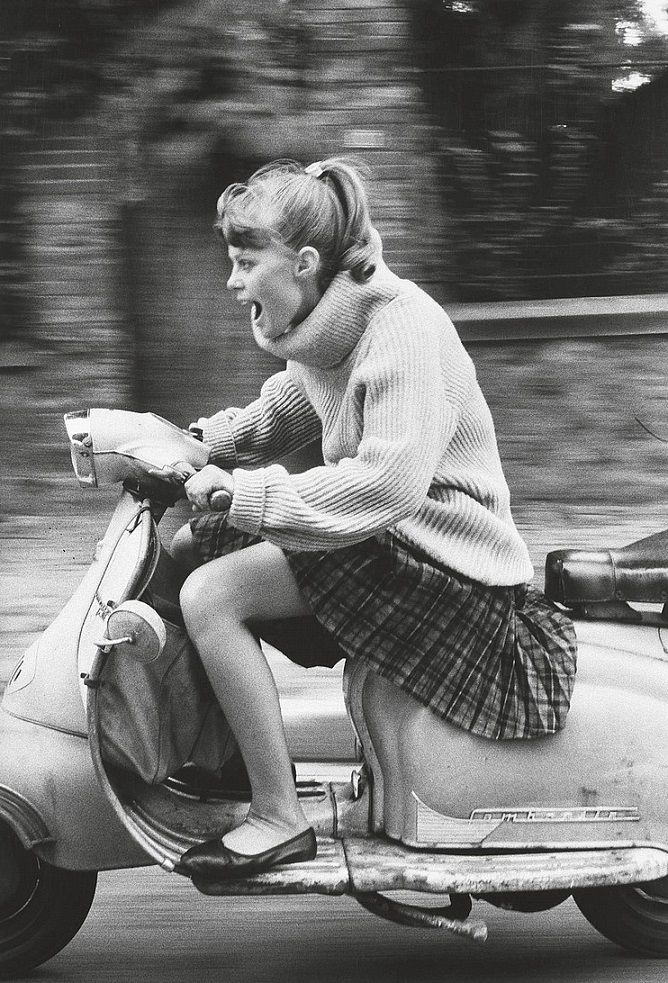 Woman riding a scooter. Photo by Jean-François Jonvelle, 1984. ☀ #photography