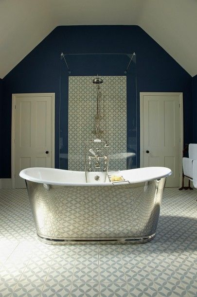 La Rochelle Polished Cast Iron Bateau Bath makes a statement set against single coloured pattern tiles.