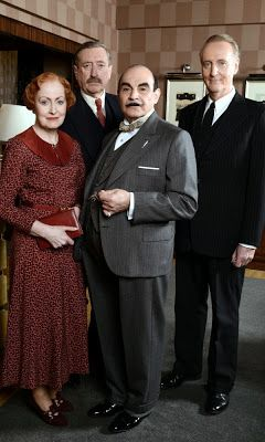 Investigating Agatha Christie's Poirot - Shown from left to right: Pauline Moran as Miss Lemon, Philip Jackson as Inspector Japp, David Suchet as Poirot, and Hugh Fraser as Captain Hastings.