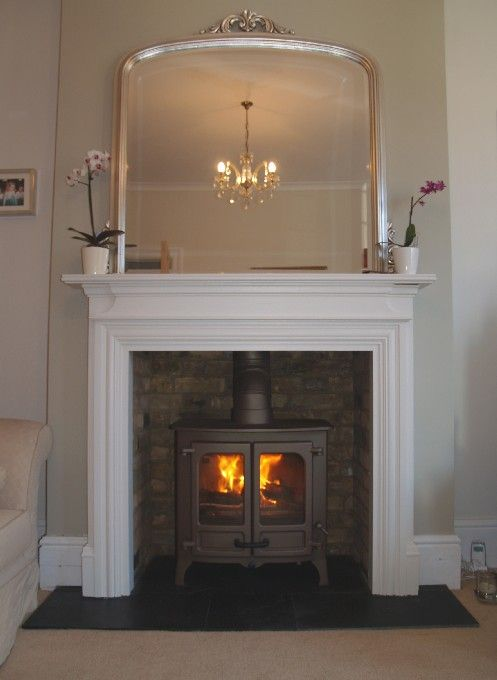 MDF mantel with reclaimed brick slip chamber, natural slate tiled hearth and bronze Charnwood Island 2 multi fuel stove. Fitted in westcliff on Sea Essex 2008
