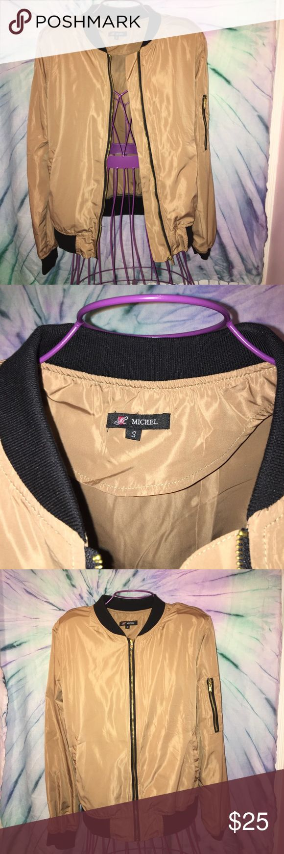 Tan bomber jacket Tan bomber jacket in size small. With pockets on waist and on left shoulder. Black trimming with gold detail zipper. WORN ONCE. IN GREAT SHAPE. Jackets & Coats