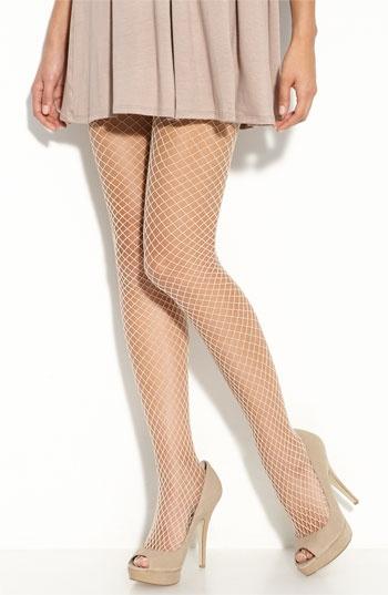 Flesh colored fishnet tights. I LOOOOVE flesh colored ...