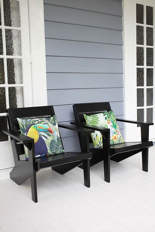 Louise Dunning repainted these Cape Cod chairs in Resene Black, which look great on the veranda boards, painted in Resene Walk-on tinted to Resene White Pointer.