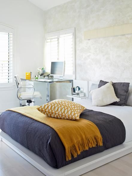 """Sleek, bright spaces can feel empty and cold if you don't balance the light with warm, grounding elements. In this young girl's bedroom, designer Peggy Dupuis used small touches of mustard yellow to spice up the cool gray and white palette. """"The yellow is not very saturated,"""" says the designer. """"But in this space it's perfect for creating an atmosphere that's just right for relaxation and study."""""""