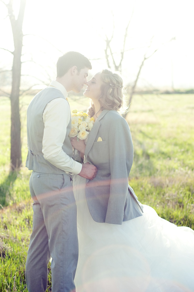 I love pictures of the bride wearing the groom's suit coat!