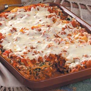 Beef and Spinach Lasagna Recipe -Using no-cook noodles gives you a jump start on assembling this hearty main dish that Carolyn Schmeling of Brookfield, Wisconsin recommends. It cuts nicely after standing a few minutes, revealing flavorful layers.