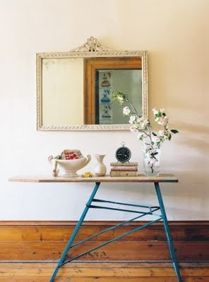 vintage ironing board repurposed into a creative table ~ would work great in a narrow entryway or a porch