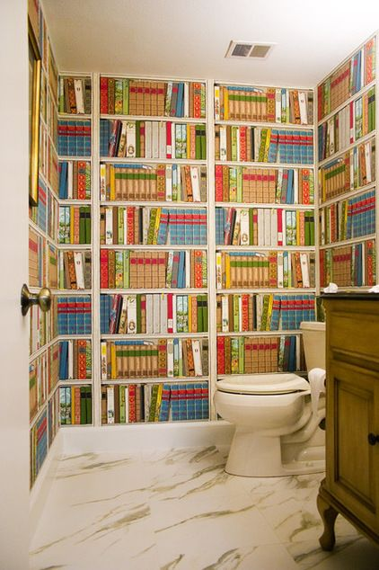 The very best ever bathroom wallpaper. I'd add a real magazine rack at toilet level.  traditional bathroom by Angela Gutekunst Interiors, Inc.