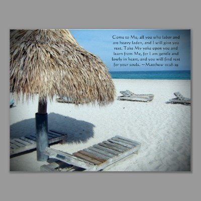 Scenic photograph of a relaxing beach with white sand and clear blue water and a blue sky. Straw coconut palm front beach cabana umbrella with wood lounge chairs beneath. Bible verse from reads... Come to Me, all you who labor and are heavy laden, and I will give you rest. Take My yoke upon you and learn from Me, for I am gentle and lowly in heart, and you will find rest for your souls. ~Matthew 11:28-29 Great inspirational Christian Religious Artwork Art Print Poster Gift for anyone!
