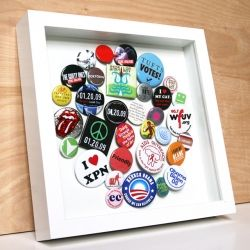 A fantastic way to display a special pin collection.  I make a shadow box of pins/charms of my trips.