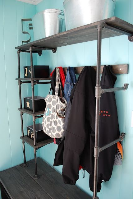 pipe shelves..These would look great in a utility room or even in our garage for organization..just add more shelving for exterior use! (Would look cool in a boy's room as well!)