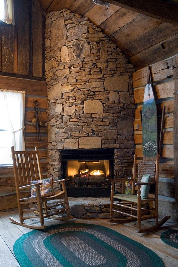 A warm fireplace in a cabin rental in bryson city is a for Indoor fireplace design