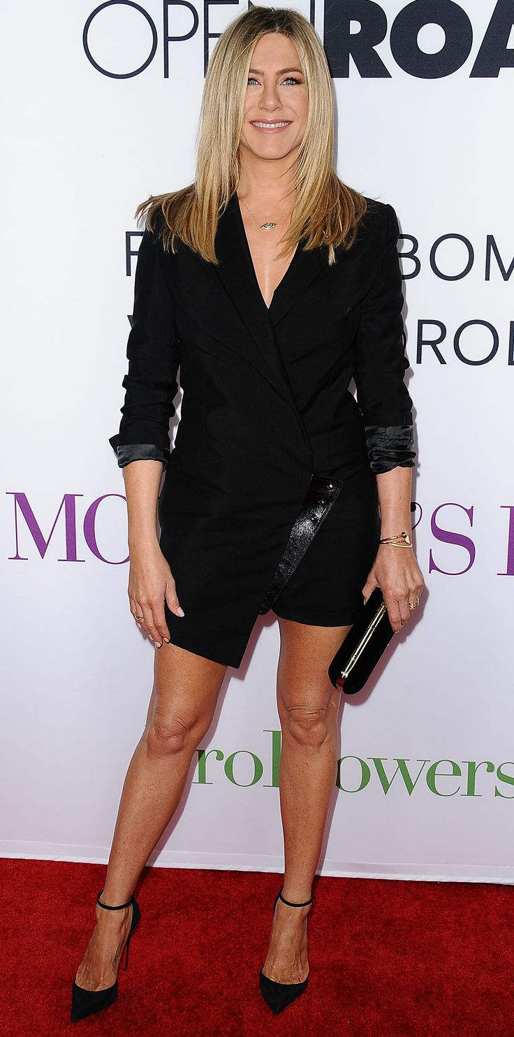 Jennifer Aniston went with her go-to little black dress for the world premiere of Mother's Day, but she found one with a twist—she wore a sleek black menswear-inspired number (with her sleeves haphazardly scrunched up) that featured a wrap silhouette and an asymmetric hem. Select gold jewelry, a black minaudiere, and black ankle-strap Louboutin pumps rounded out her look.