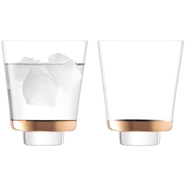 LSA+Edge+Tumbler+325ml+Set+of+2+-+Rose+Gold+-+Set+of+2+Art+Deco+glass+tumblers+with+rose+gold+decoration. Enjoy+your+whisky+or+bourbon+on+the+rocks+with+the+LSA+Edge+Tumbler+set+of+2. Contemporary+with+timeless+appeal,+each+glass+features+a+commanding+architectural+silhouette+with+conically+formed+tall+stems+and+tapered+disc+feet. Inspired+by+the+vintage+glamour+of+1920s+Art+Deco+glassware,+the+design+is+complete+with+a+rose+gold+hand+painted+base,+adding+a+touch+of+indulgence+to+your+ser...