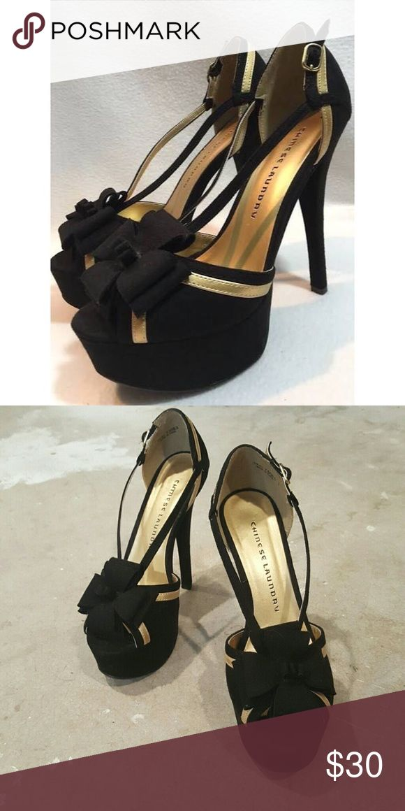Chinese Laundry black and gold platform heels Black suede heels with gold details and bow. Worn a few times, no marks or damages. Very comfortable and sexy. Chinese Laundry Shoes Platforms