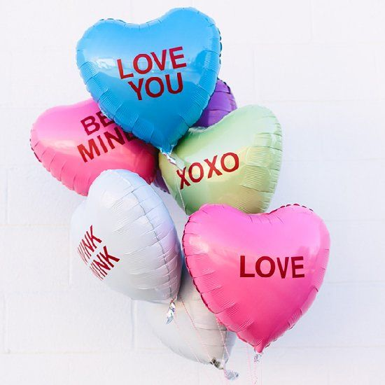 Turn heart balloons into conversation heart balloons with vinyl stickers!