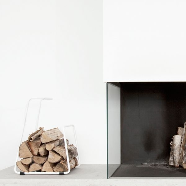 Modern fireplace and log storage.