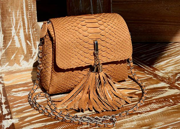 http://www.ebay.com/itm/100-GENUINE-PYTHON-SNAKE-LEATHER-BAG-MEDIUM-SIZED-HEIGHT-6-3-BEIGE-/271776378626?pt=LH_DefaultDomain_0&hash=item3f47226f02